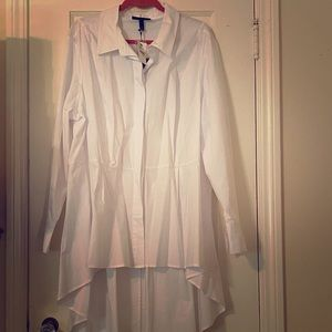 White hi-low blouse with hidden buttons.